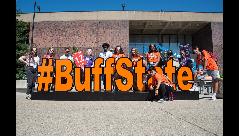 New students with the #BuffState sign outside