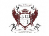 Zeta Chi Omega logo - shield with two brown eagle wings coming from the side