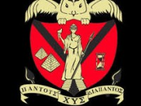 Chi Upsilon Sigma Logo of a shield with a statue in the middle of it and an owl hovering above